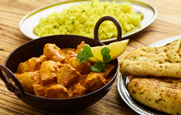 Chicken Makhani with Basmati Rice and Garlic and Coriander Naan