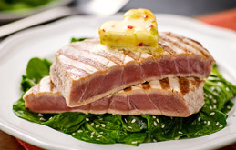 Grilled tuna steaks with heart-shaped chilli and lime butter