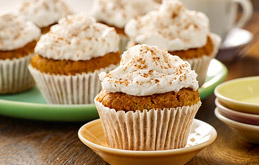 Carrot Cake Muffins with Coconut Frosting